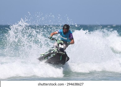 Fistral Beach, Newquay, Cornwall, UK. 6th June, 2015. Professional jet ski riders compete at the IFWA World Tour Jet Ski Championship. Contestants perform numerous tricks for judges in the waves.