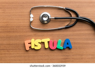 fistula colorful word on the wooden background with stethoscope