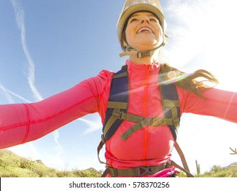 Fit active girl riding her bike on a mountain bike path on a sunny day