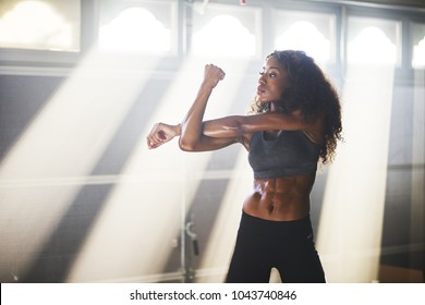 fit african american woman doing stretches before work out