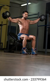 Fit Athlete Working Out Shoulders - Dumbbell Concentration Curls