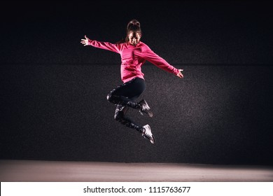 Fit athletic girl in mid-air expressionism.