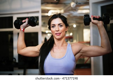 Fit attractive woman show weight in gym