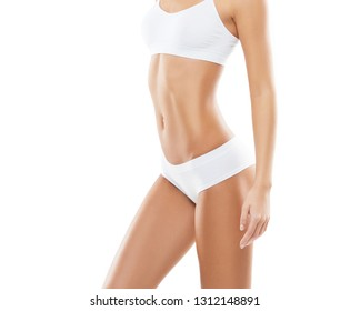 Fit and beautiful female body. Young girl in white swimsuit.