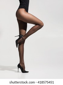 Fit and beautiful legs in sexy pantyhose