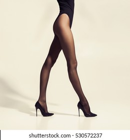 Fit and beautiful legs in sexy pantyhose. Woman walking in hosiery.