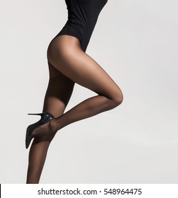 Fit and beautiful legs in sexy pantyhose. Woman in hosiery.