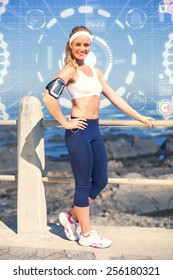 Fit blonde listening to music against fitness interface