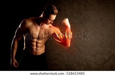 Fit bodybuilder lifting weight