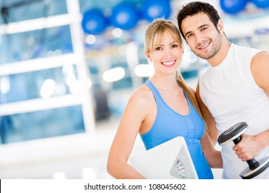 Fit couple at the gym looking very attractive