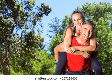 Fit couple having fun in the park on a sunny day