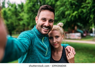 Fit couple making selfie.