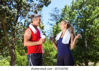 Fit couple in the park on a sunny day