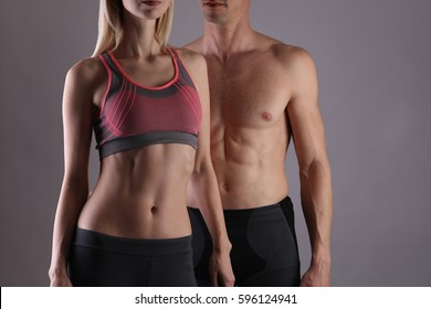 Fit couple, strong muscular man and slim woman . Sport, fitness ,workout concept. Copy space