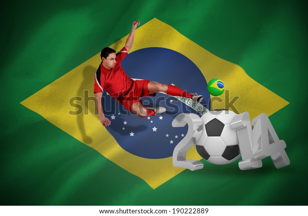 Fit football player jumping and kicking against 2014 with brasil flag