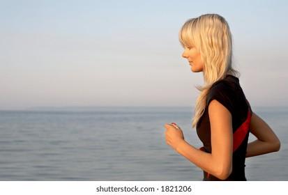 fit girl jogging at the seashore