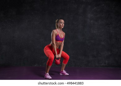 Fit girl with kettle -bell.