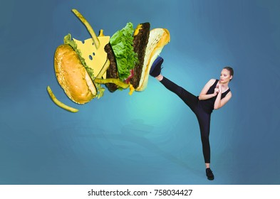 fit girl kicking off hamburger junk food health concept