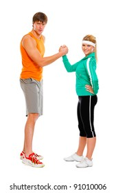 Fit girl and man in sportswear  shaking hands