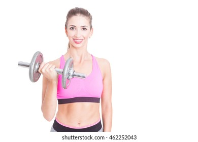 Fit girl posing holding heavy weight at gym isolated on white background with copy advertising area
