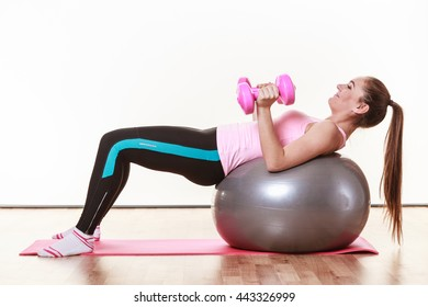 Fit girl working out. Young woman exercising in gym. Health fitness activity concept.