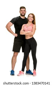 Fit happy couple: strong muscular man and slim woman posing on white background