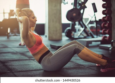 Fit and healthy body. Woman at gym.