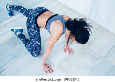 Fit and healthy personal trainer working out, doing HIIT.