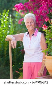 fit healthy senior woman gardening