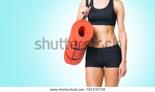 Fit, healthy and sporty woman in sportswear over cyan background.
