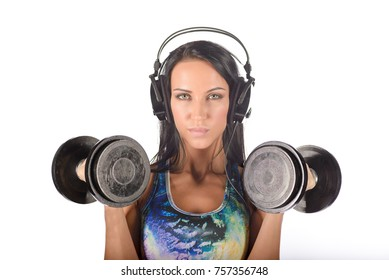 Fit healthy woman with barbells and earphones