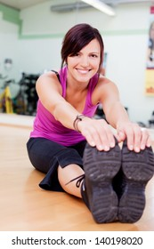 Fit and healthy woman stretching touching toes