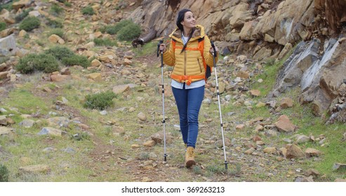 Fit healthy young woman hiking on a trail