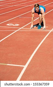 Fit male athlete on second running track