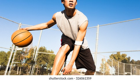 Fit male playing basketball outdoor