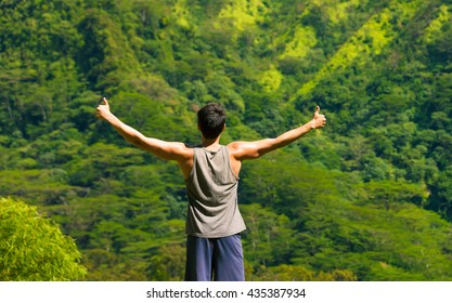 Fit male with with thumbs up enjoying the great outdoors.