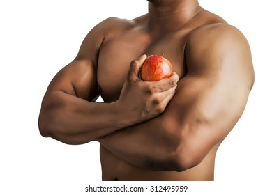 Fit man body with hand holding apple isolated on white background.
