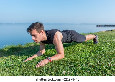 Fit man doing plank core exercise working on abdominal back muscles