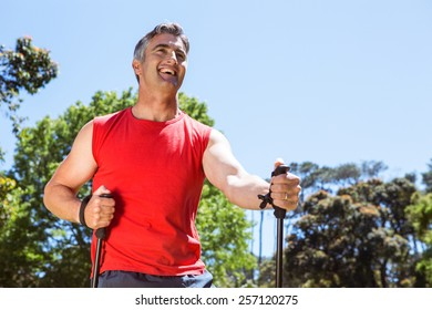 Fit man hiking in the park on a sunny day