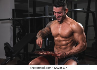 Fit muscular boy eat clean in the gym.