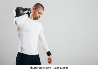 Fit muscular man posing at studio/ Fit muscular man posing at studio