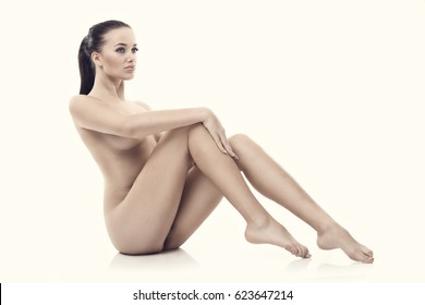 Fit naked woman isolated on white