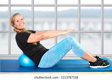 Fit pensioner is doing gymnastics in a gym