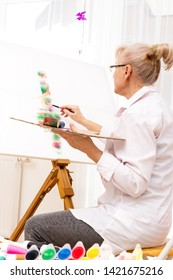 A fit pensioner with her hobby in the studio
