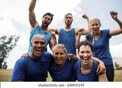 Fit people cheering together in boot camp