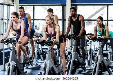 Fit people working out at class in the gym