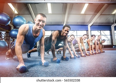 Fit people working out in fitness class at gym
