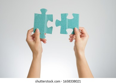 the fit pieces of puzzle in the female hands