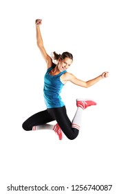 fit runner girl jumping with happy expression against white background
