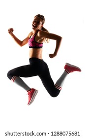 fit runner girl jumping with happy expression against white background, half silhouette photo